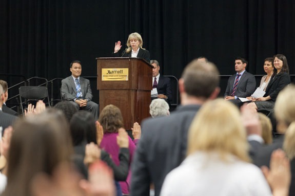 All raise their hands to take the oath from 1st District Court of Appeal Clerk/Administrator Diana Herbert to become new members of the bar.   <em>Photo by S. Todd Rogers</em>